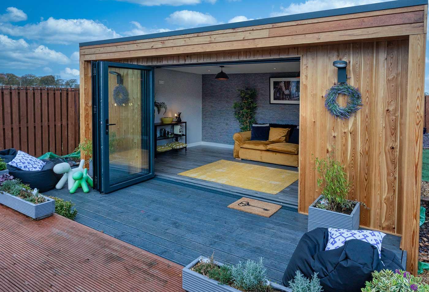 Garden Room Made Of Timber With Bifold Doors